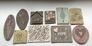 Finished ceramic plaques from our Carers Connect workshop.